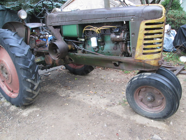 19) Oliver 77 Row Crop Tractor In Yard