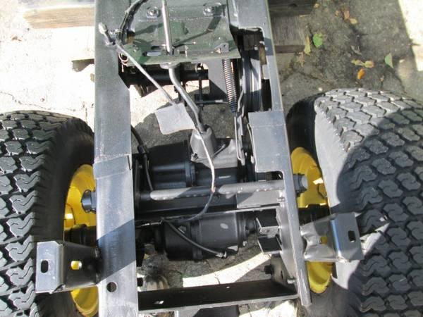 2) John Deere 216 Tractor