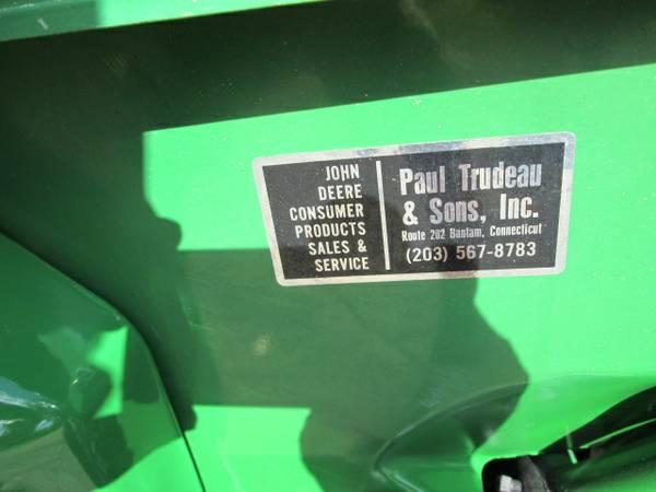 7) John Deere 216 Tractor