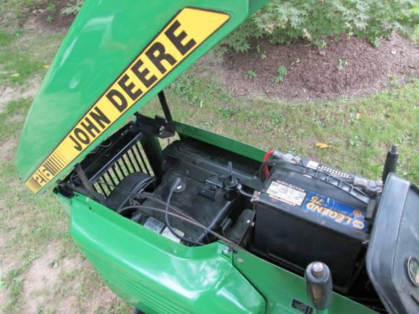 8) John Deere 216 Tractor