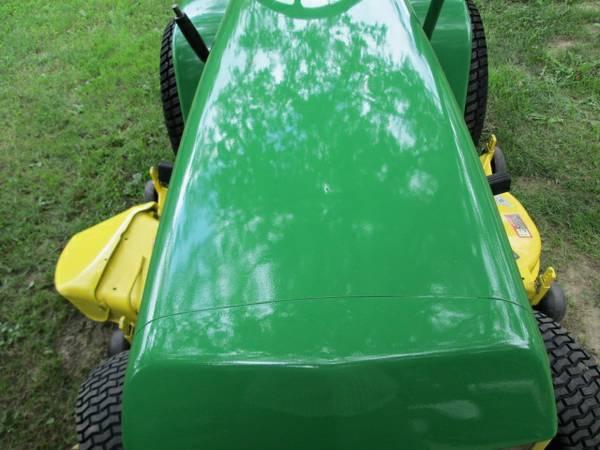9) John Deere 216 Tractor