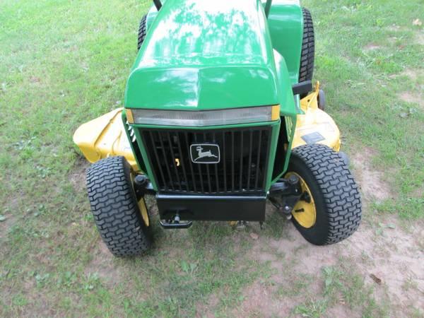 10) John Deere 216 Tractor