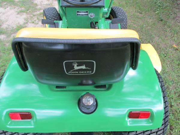 11) John Deere 216 Tractor
