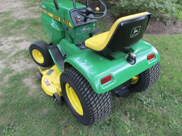12) John Deere 216 Tractor