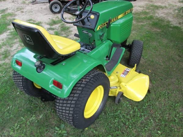 13) John Deere 216 Tractor