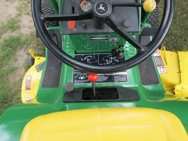 14) John Deere 216 Tractor