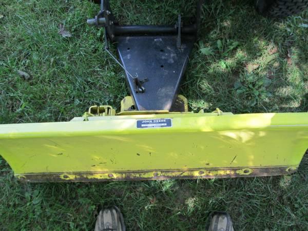 16) John Deere 216 Tractor