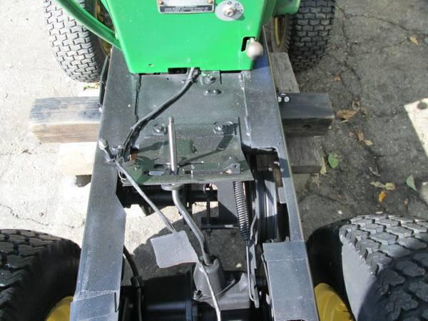 3) John Deere 216 Tractor