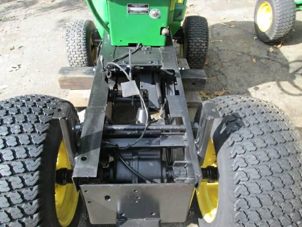 4) John Deere 216 Tractor