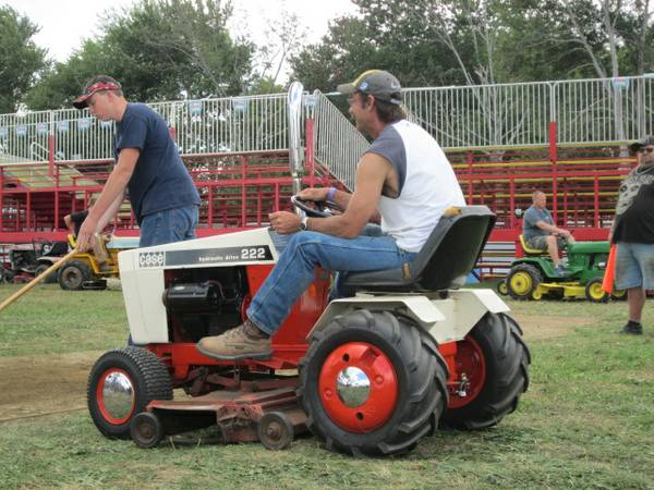 Guy Fixing Tractor : The tractor guys pull n
