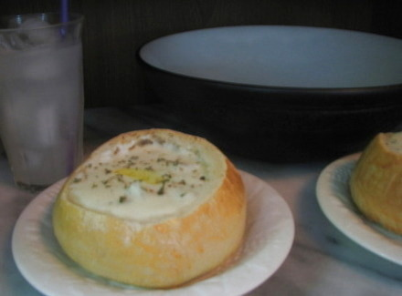 New England Clam Chowder, shown in a home-baked bread bowl